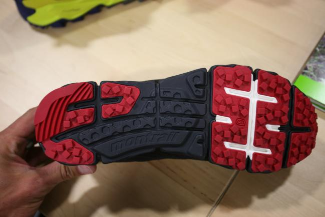 Co-molded EVA rock plate in the forefoot (white color) and harder midsole in the midfoot that you can't see visually but can feel when you hold the shoe.